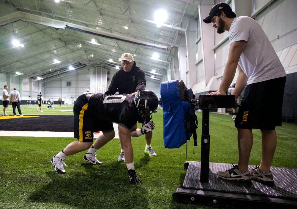 Iowa Hawkeyes defensive line coach Reese Morgan works with linebacker Parker Hesse (40) during their third bowl practice Friday, Dec. 19, 2014 in the indoor practice facility.  (Brian Ray/hawkeyesports.com)