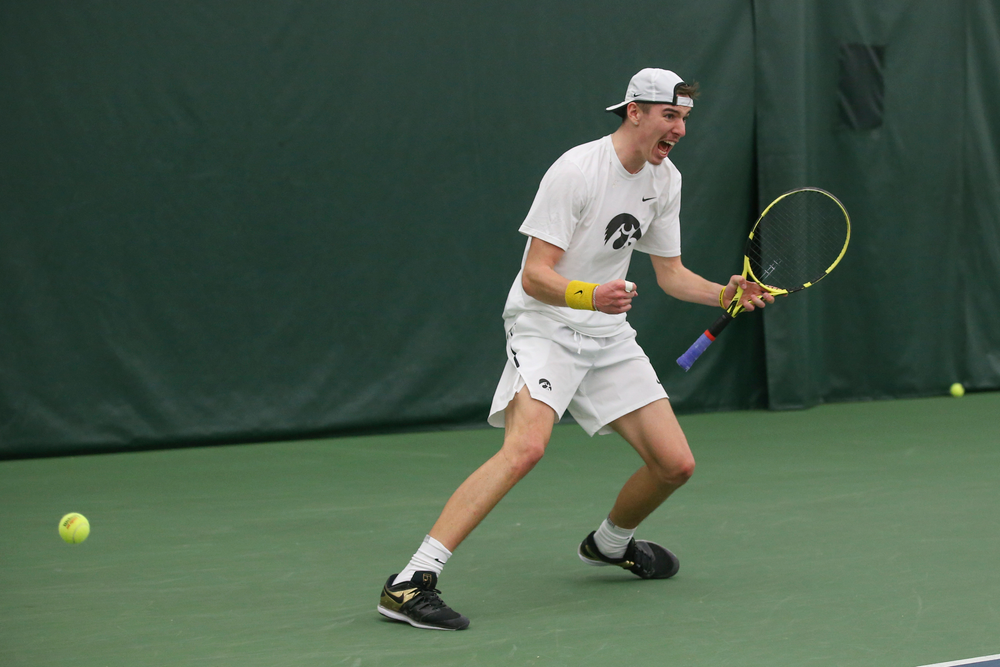 Iowa's Nikita Snezhko celebrates a point during the Iowa men's tennis meet vs Nebraska on Sunday, March 1, 2020 at the Hawkeye Tennis and Recreation Complex. (Lily Smith/hawkeyesports.com)