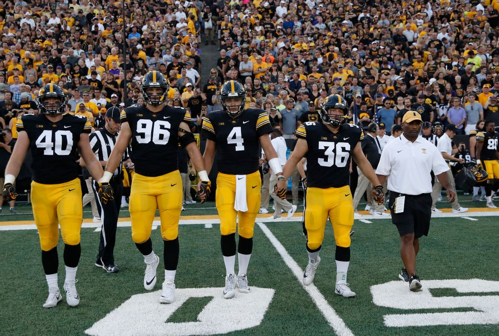 Captains Iowa Hawkeyes defensive end Parker Hesse (40), defensive end Matt Nelson (96), quarterback Nate Stanley (4), fullback Brady Ross (36) and honorary captain Marvin Sims, Jr. against the Northern Iowa Panthers Saturday, September 15, 2018 at Kinnick Stadium. (Brian Ray/hawkeyesports.com)