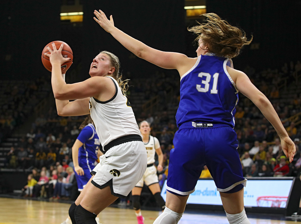 Iowa Hawkeyes forward Monika Czinano (25) eyes the basket before making a bucket during the second quarter of their game at Carver-Hawkeye Arena in Iowa City on Saturday, December 21, 2019. (Stephen Mally/hawkeyesports.com)