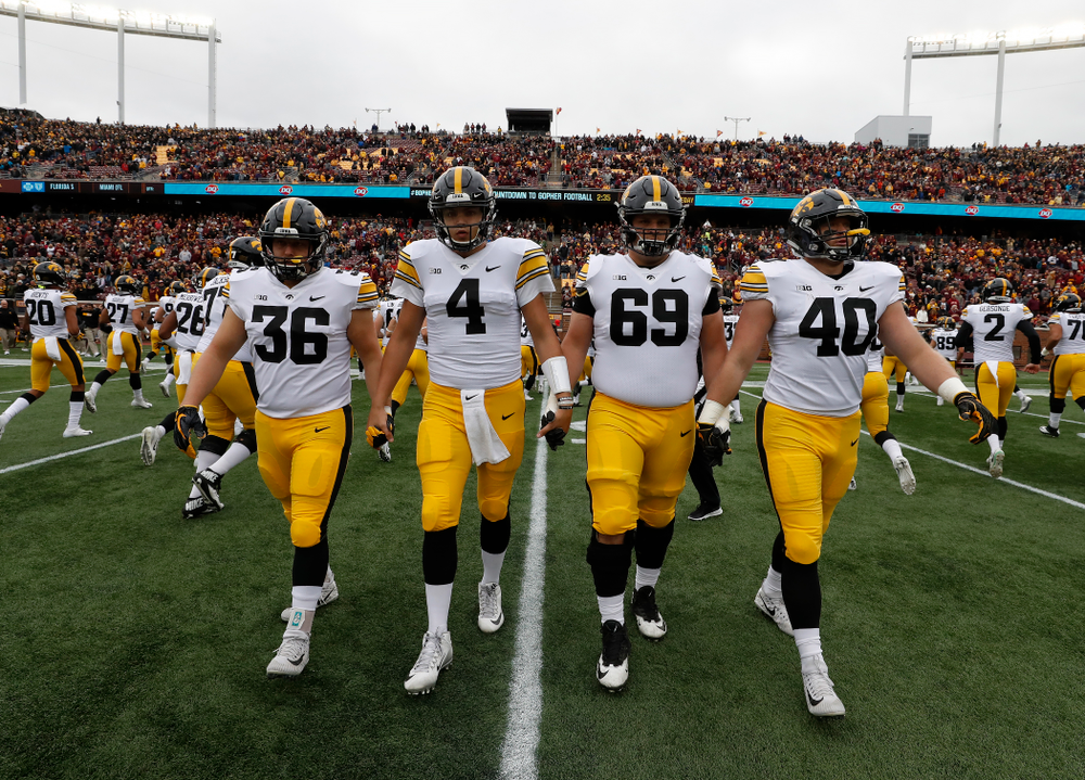 Iowa Hawkeyes captains fullback Brady Ross (36), quarterback Nate Stanley (4), offensive lineman Keegan Render (69), and defensive end Parker Hesse (40) against the Minnesota Golden Gophers Saturday, October 6, 2018 at TCF Bank Stadium. (Brian Ray/hawkeyesports.com)