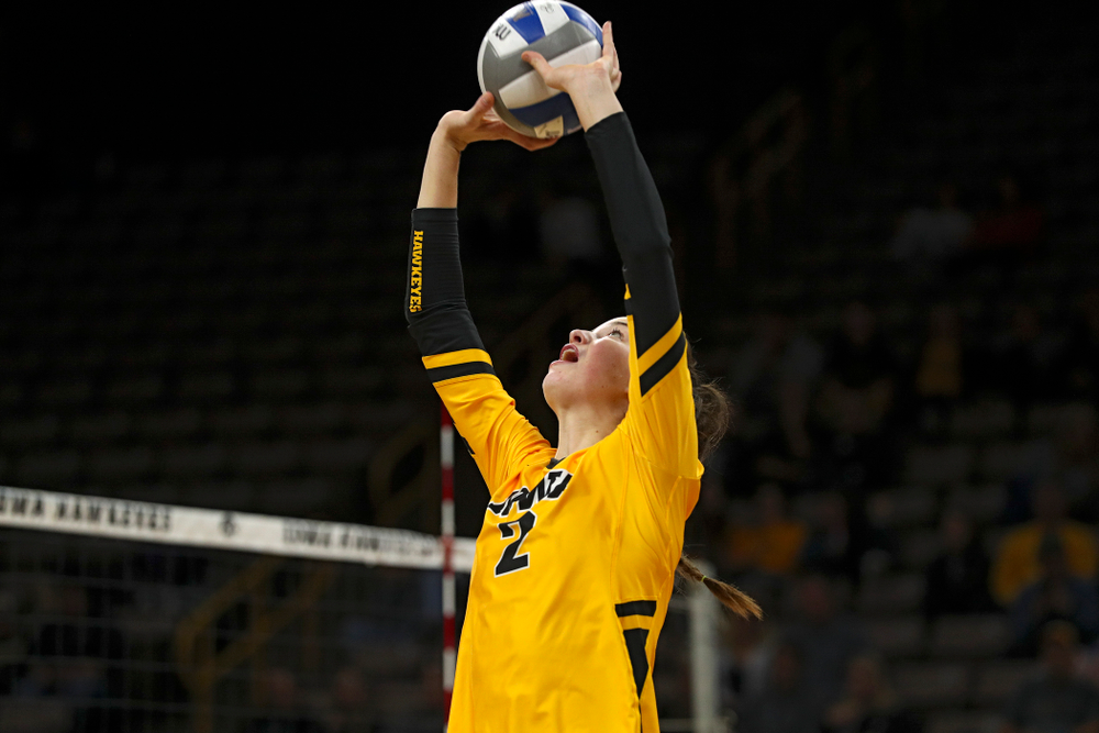Iowa's Courtney Buzzerio (2) sets the ball during the third set of their match against Illinois at Carver-Hawkeye Arena in Iowa City on Wednesday, Nov 6, 2019. (Stephen Mally/hawkeyesports.com)