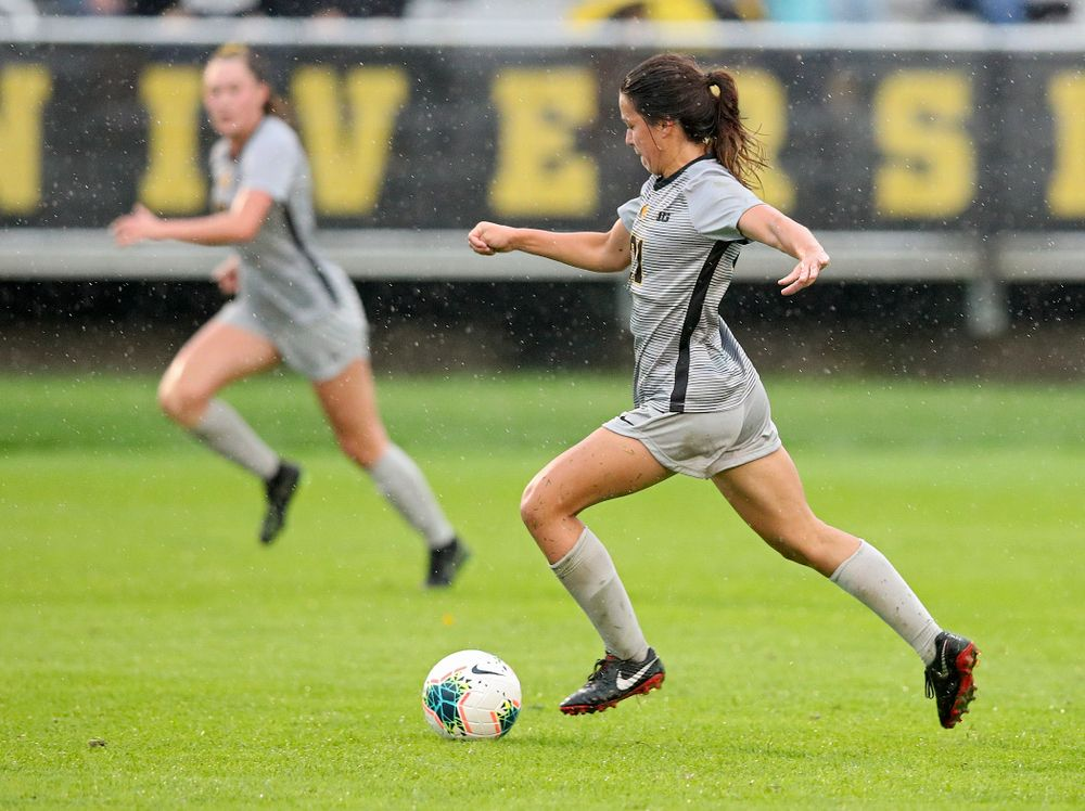 Iowa forward Emma Tokuyama (21) moves with the ball during the second half of their match at the Iowa Soccer Complex in Iowa City on Sunday, Sep 29, 2019. (Stephen Mally/hawkeyesports.com)