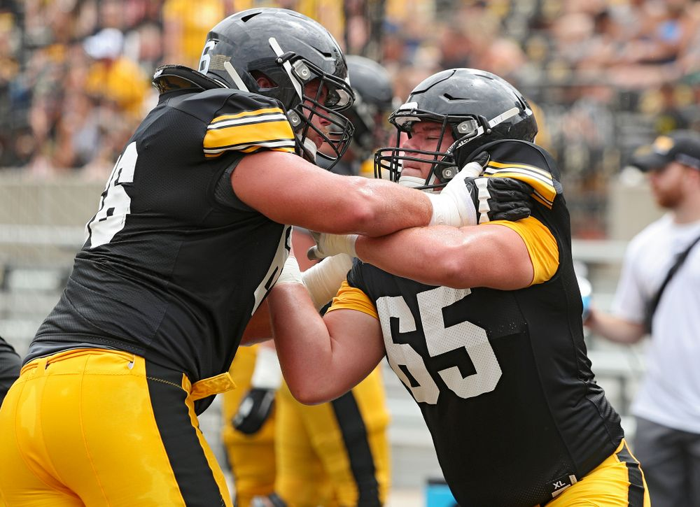 Iowa Hawkeyes offensive lineman Levi Paulsen (66) and offensive lineman Tyler Linderbaum (65) work on a drill during Fall Camp Practice No. 8 at Kids Day at Kinnick Stadium in Iowa City on Saturday, Aug 10, 2019. (Stephen Mally/hawkeyesports.com)