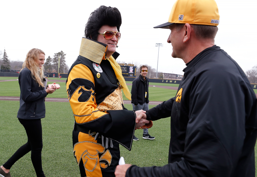 Hawkeye Elvis  and head coach Rick Heller against the Bradley Braves Wednesday, March 28, 2018 at Duane Banks Field. (Brian Ray/hawkeyesports.com)