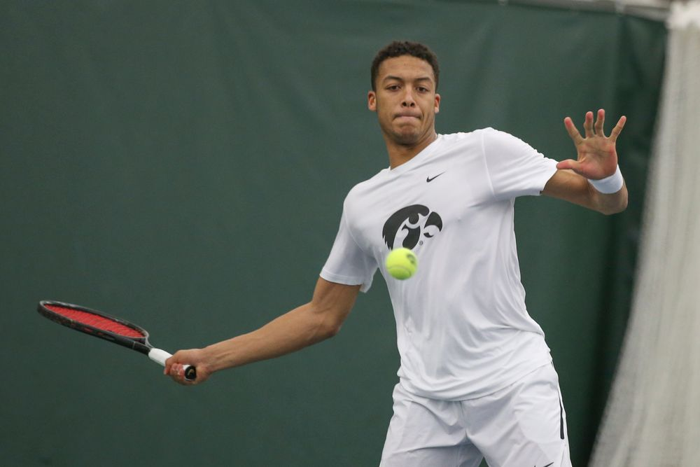 Iowa's Oliver Okonkwo returns a hit during the Iowa men's tennis meet vs Nebraska on Sunday, March 1, 2020 at the Hawkeye Tennis and Recreation Complex. (Lily Smith/hawkeyesports.com)