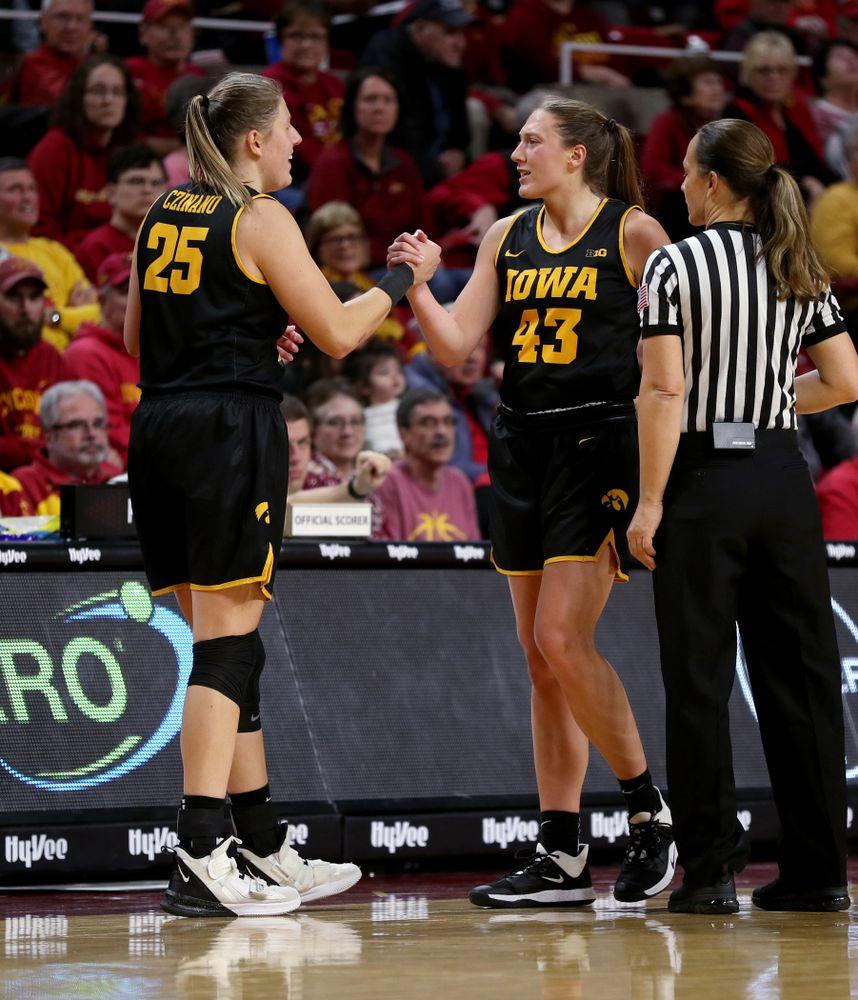 Iowa Hawkeyes forward/center Monika Czinano (25) and forward Amanda Ollinger (43) against the Iowa State Cyclones Wednesday, December 11, 2019 at Hilton Coliseum in Ames, Iowa(Brian Ray/hawkeyesports.com)