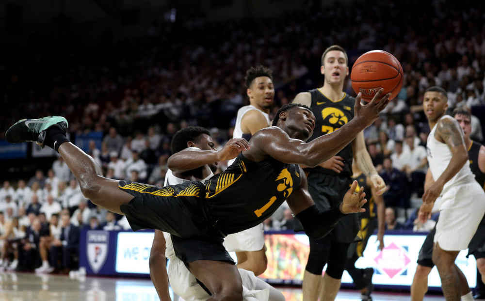 Iowa Hawkeyes guard Joe Toussaint (1) draws a foul against Penn State Saturday, January 4, 2020 at the Palestra in Philadelphia. (Brian Ray/hawkeyesports.com)