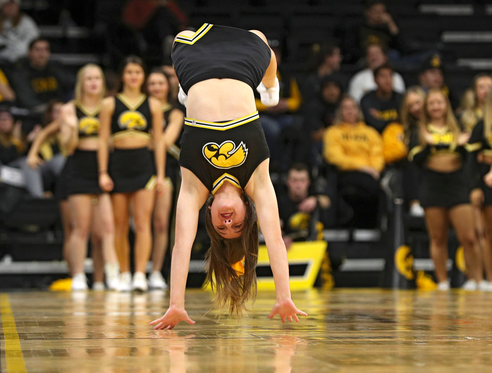 Iowa Cheerleaders do backflips down the court during the second half of their exhibition game against Lindsey Wilson College at Carver-Hawkeye Arena in Iowa City on Monday, Nov 4, 2019. (Stephen Mally/hawkeyesports.com)