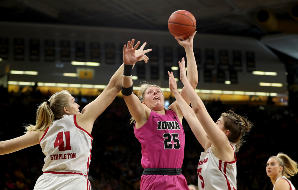 Iowa Hawkeyes forward/center Monika Czinano (25) goes to the hoop against the Wisconsin Badgers Sunday, February 16, 2020 at Carver-Hawkeye Arena. (Brian Ray/hawkeyesports.com)