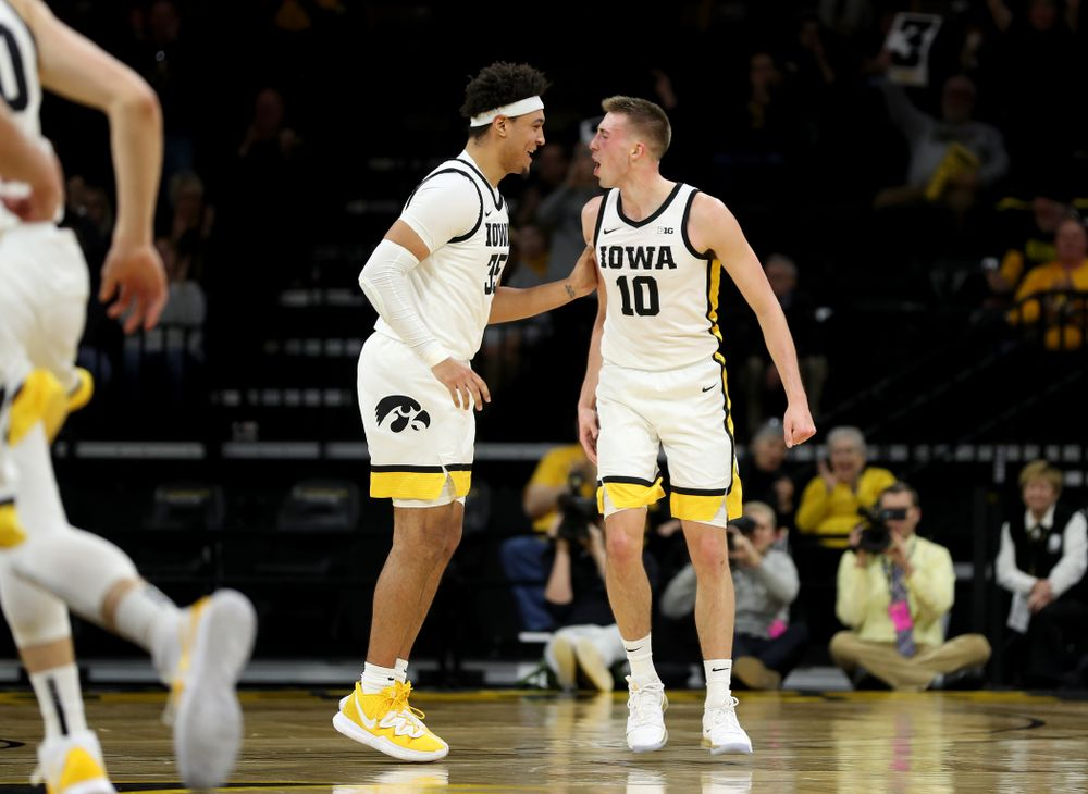 Iowa Hawkeyes guard Joe Wieskamp (10) celebrates a three point basket with forward Cordell Pemsl (35) against the Maryland Terrapins Friday, January 10, 2020 at Carver-Hawkeye Arena. (Brian Ray/hawkeyesports.com)