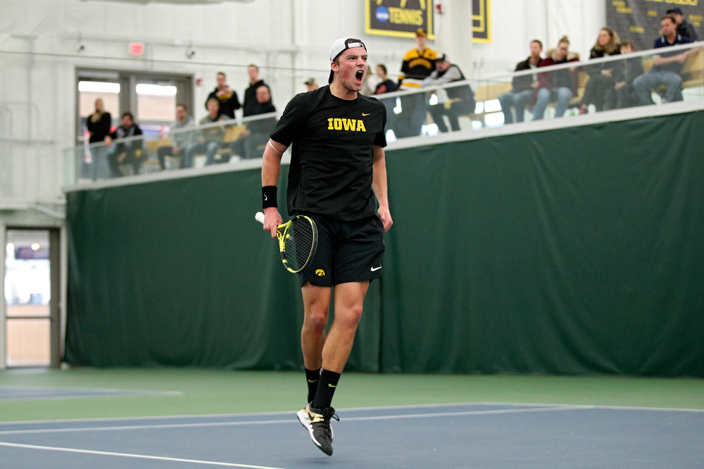 Iowa's Joe Tyler celebrates after winning his match against Marquette at the Hawkeye Tennis and Recreation Complex in Iowa City on Saturday, January 25, 2020. (Stephen Mally/hawkeyesports.com)