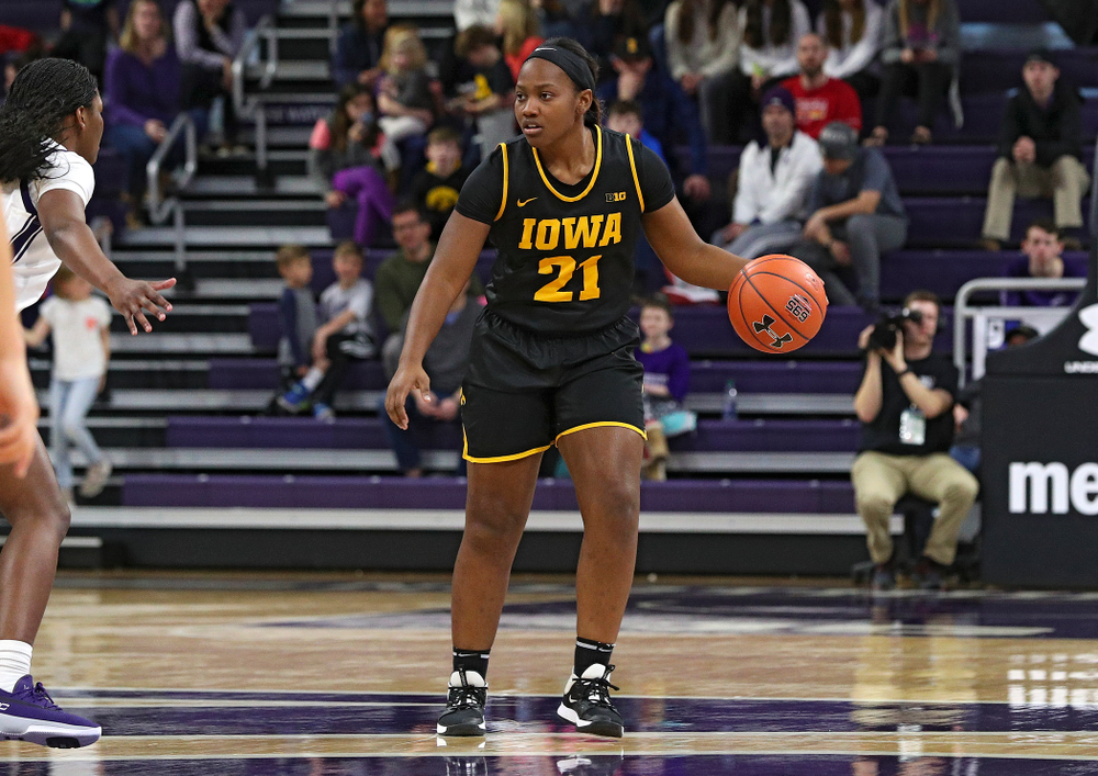 Iowa Hawkeyes guard Zion Sanders (21) brings the ball down the court during the fourth quarter of their game at Welsh-Ryan Arena in Evanston, Ill. on Sunday, January 5, 2020. (Stephen Mally/hawkeyesports.com)