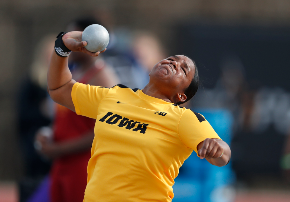 Iowa's Iowa's Nia Britt competes in the shot put during the 2018 MUSCO Twilight Invitational  Thursday, April 12, 2018 at the Cretzmeyer Tra