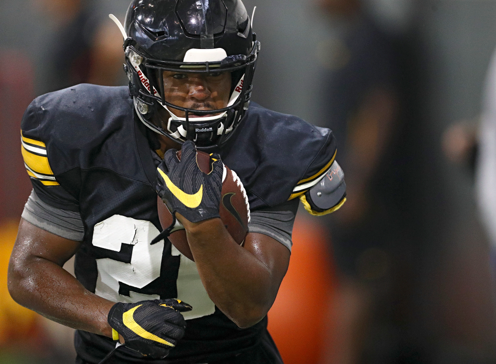 Iowa Hawkeyes running back Ivory Kelly-Martin (21) runs a drill during Fall Camp Practice No. 9 at the Hansen Football Performance Center in Iowa City on Monday, Aug 12, 2019. (Stephen Mally/hawkeyesports.com)