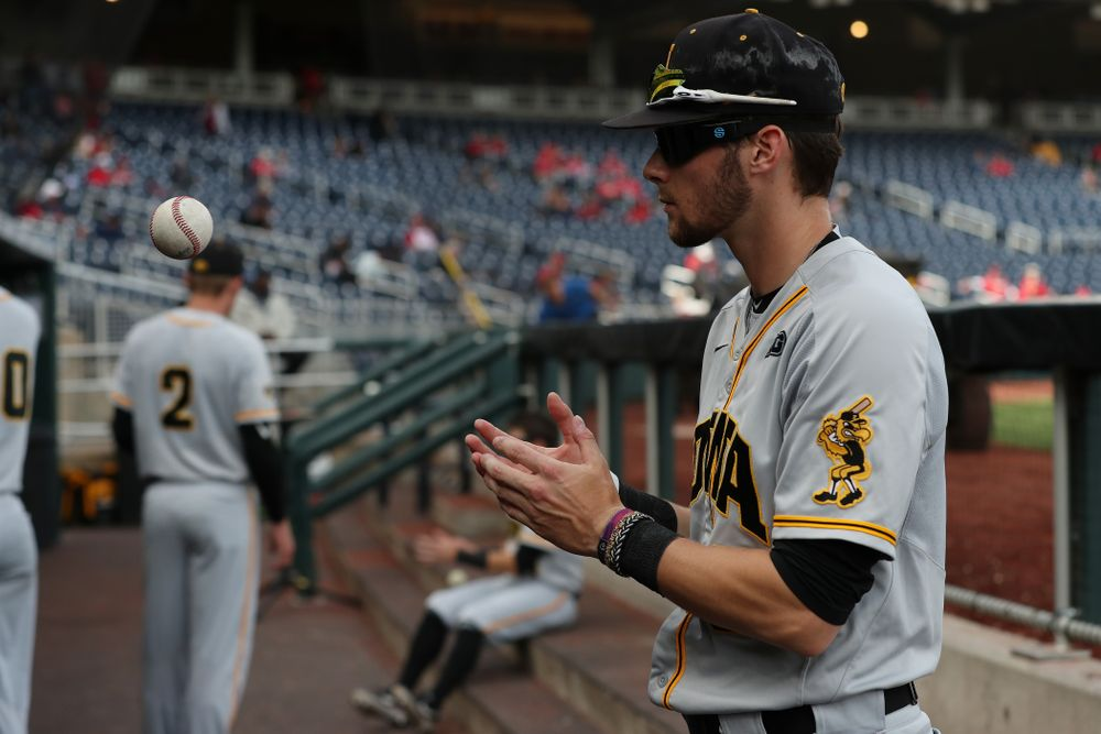 Iowa Hawkeyes outfielder Ben Norman (9) wears special goggles that flicker to improve hand eye coordination before their game against the Indiana Hoosiers in the first round of the Big Ten Baseball Tournament Wednesday, May 22, 2019 at TD Ameritrade Park in Omaha, Neb. (Brian Ray/hawkeyesports.com)