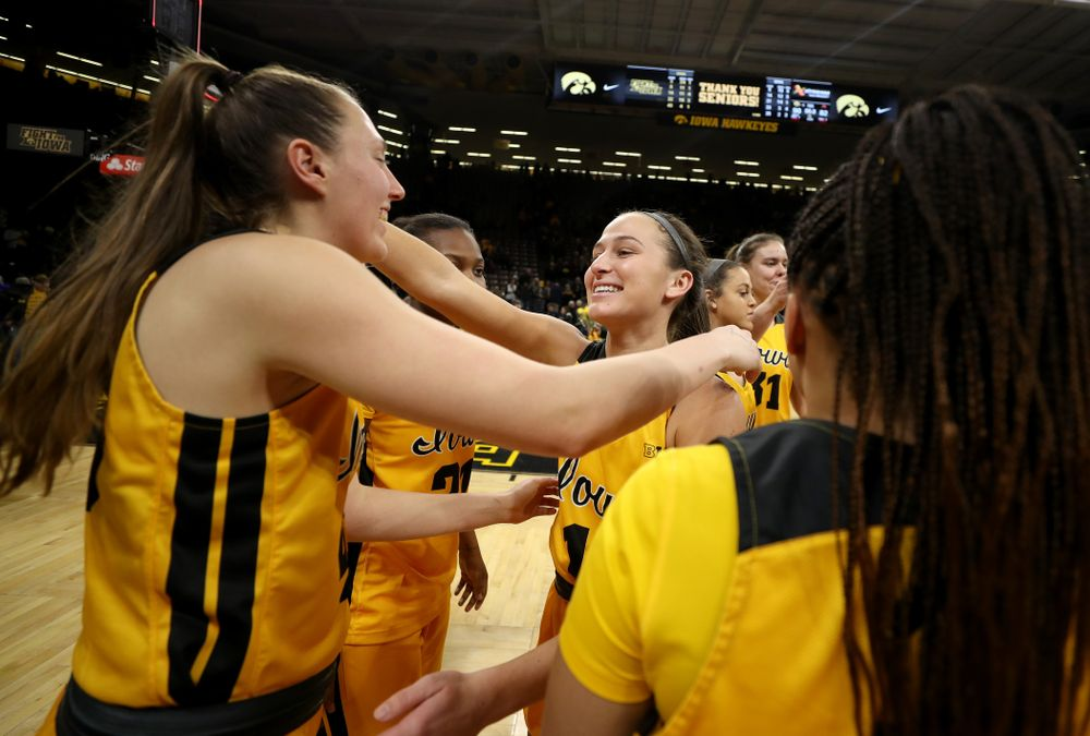 Iowa Hawkeyes forward Amanda Ollinger (43) hugs guard Megan Meyer (11) during senior day activities following their win over the Minnesota Golden Gophers Thursday, February 27, 2020 at Carver-Hawkeye Arena. (Brian Ray/hawkeyesports.com)