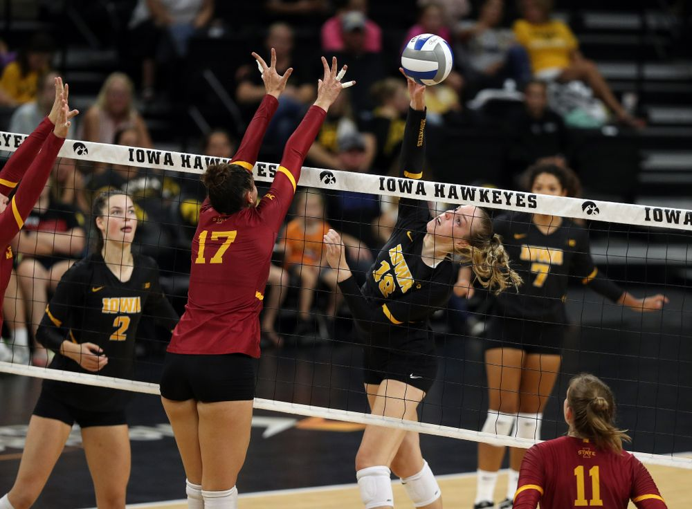 Iowa Hawkeyes middle blocker Hannah Clayton (18) hits the ball against the Iowa State Cyclones Saturday, September 21, 2019 during the Iowa Corn Cy-Hawk Series Tournament at Carver-Hawkeye Arena. (Brian Ray/hawkeyesports.com)