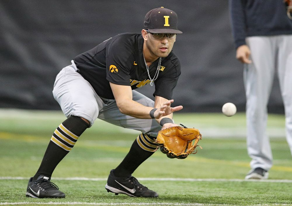 Iowa Hawkeyes infielder Matthew Sosa (31) fields a ball during practice at the Hansen Football Performance Center in Iowa City on Friday, January 24, 2020. (Stephen Mally/hawkeyesports.com)