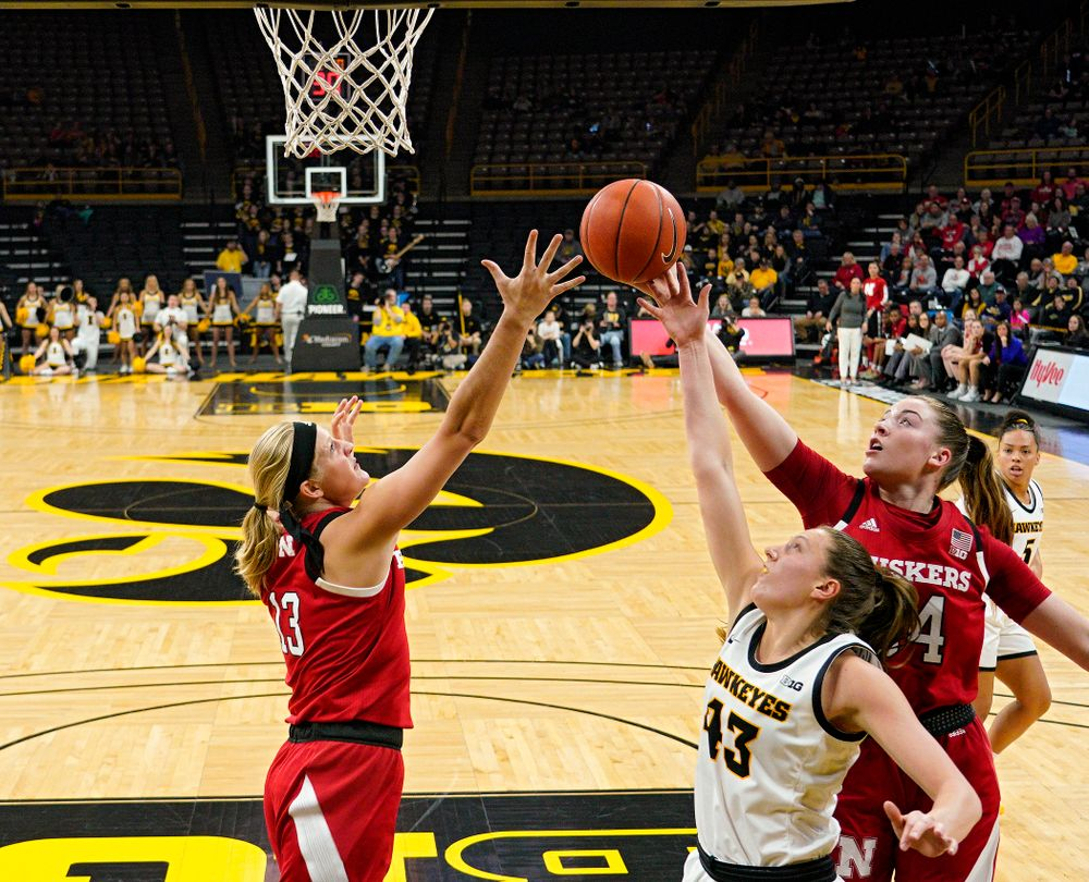 Iowa Hawkeyes forward Amanda Ollinger (43) battles for a rebound during the first quarter of the game at Carver-Hawkeye Arena in Iowa City on Thursday, February 6, 2020. (Stephen Mally/hawkeyesports.com)