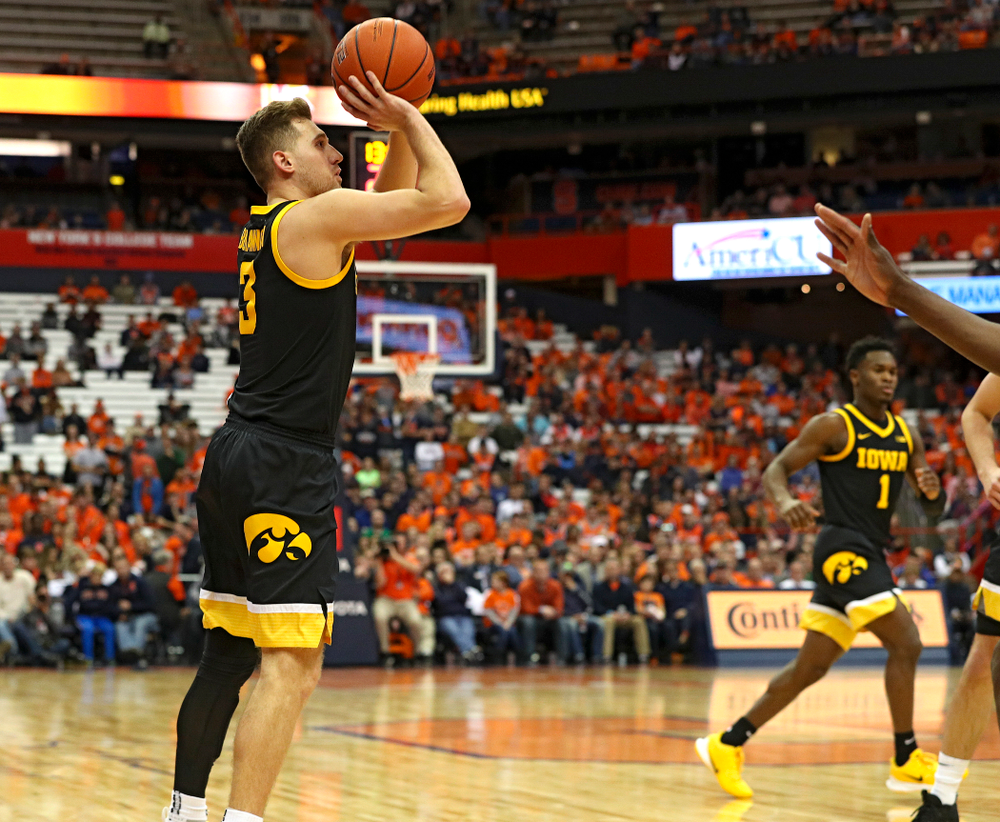 Iowa Hawkeyes guard Jordan Bohannon (3) makes a 3-pointer during the second half of their ACC/Big Ten Challenge game at the Carrier Dome in Syracuse, N.Y. on Tuesday, Dec 3, 2019. (Stephen Mally/hawkeyesports.com)