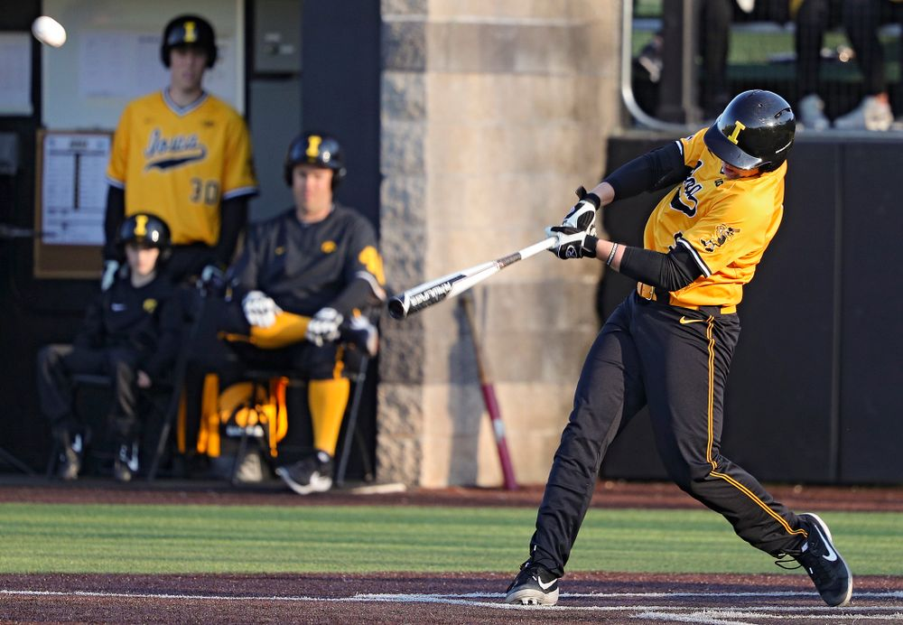 Iowa Hawkeyes pinch hitter Zeb Adreon (5) hits a triple during the seventh inning of their game at Duane Banks Field in Iowa City on Tuesday, Apr. 2, 2019. (Stephen Mally/hawkeyesports.com)
