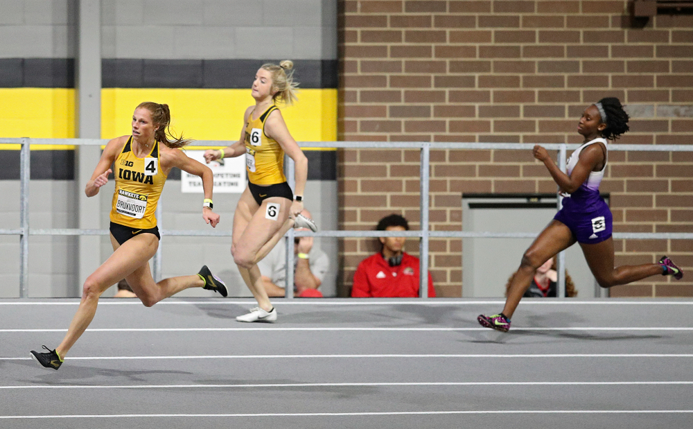 Iowa's Mariel Bruxvoort (from left) and Sydney Winger run the women's 200 meter dash event during the Hawkeye Invitational at the Recreation Building in Iowa City on Saturday, January 11, 2020. (Stephen Mally/hawkeyesports.com)