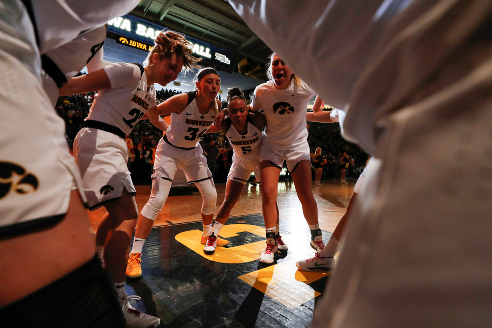 Iowa Hawkeyes forward Carly Mohns (34), guard Alexis Sevillian (5), forward Hannah Stewart (21)