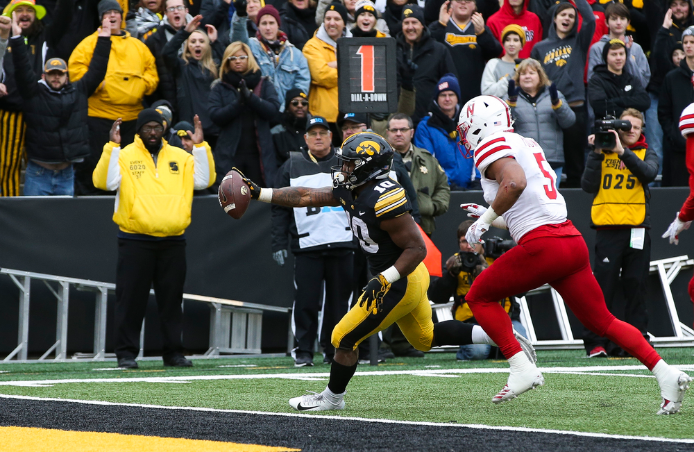 Iowa Hawkeyes running back Mekhi Sargent (10) scores a touchdown during a game against Nebraska at Kinnick Stadium on November 23, 2018. (Tork Mason/hawkeyesports.com)