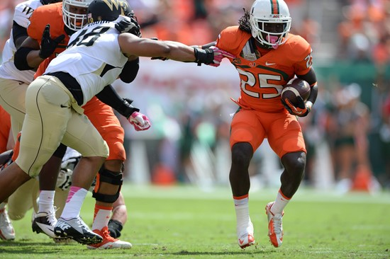 University of Miami Hurricanes running back Dallas Crawford #25 carries the ball in a game against the Wake Forest Demon Deacons at Sun Life Stadium...