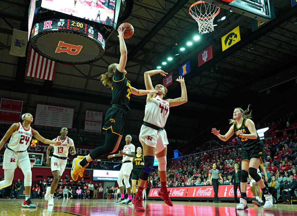 Iowa guard Kathleen Doyle (22) puts up a shot during overtime of their game at the Rutgers Athletic Center in Piscataway, N.J. on Sunday, March 1, 2020. (Stephen Mally/hawkeyesports.com)