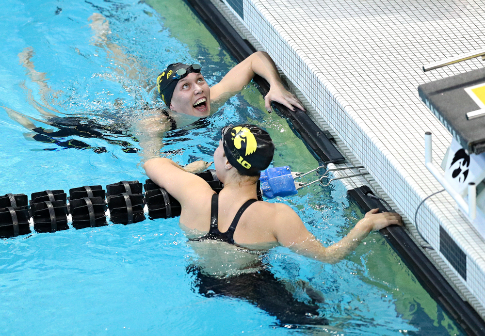 Iowa's Allyssa Fluit (from top) and Hannah Burvill (lane 4) celebrate together after swimming the women's 200 yard freestyle preliminary event during the 2020 Women's Big Ten Swimming and Diving Championships at the Campus Recreation and Wellness Center in Iowa City on Friday, February 21, 2020. (Stephen Mally/hawkeyesports.com)
