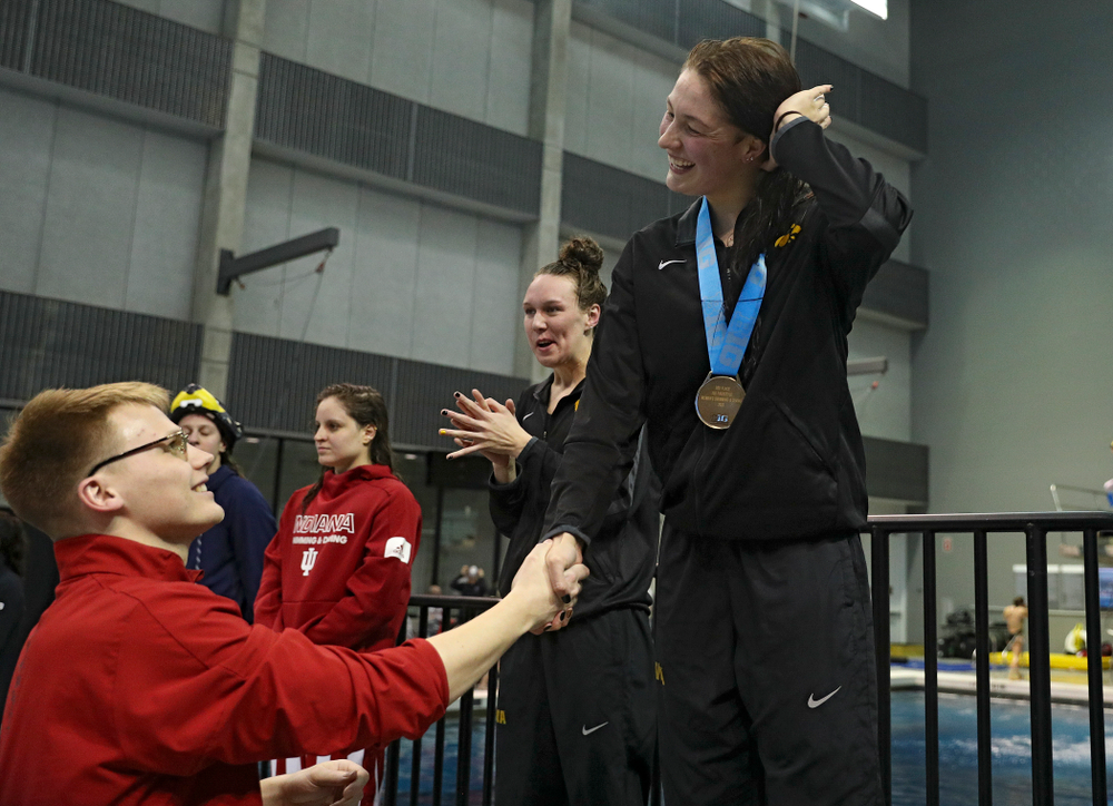 Iowa's Hannah Burvill on the awards stand after placing third in the women's 200 yard freestyle final event during the 2020 Women's Big Ten Swimming and Diving Championships at the Campus Recreation and Wellness Center in Iowa City on Friday, February 21, 2020. (Stephen Mally/hawkeyesports.com)