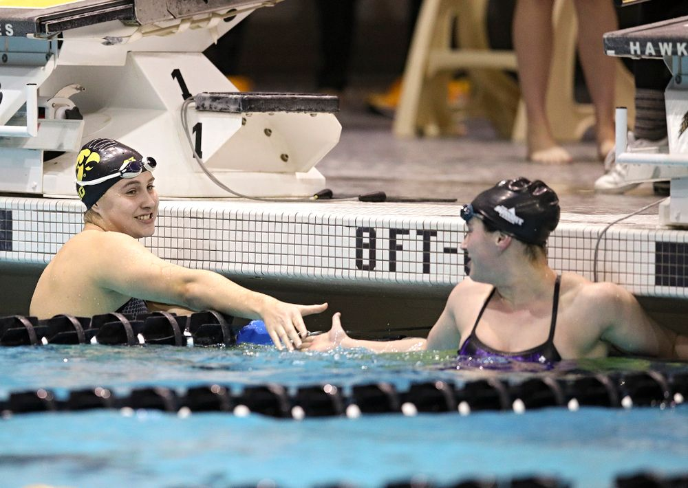 Iowa's Maddie Ziegert (from left) is congratulated by Western Illinois' Miranda Mathus after Ziegert won the women's 50 yard butterfly event during their meet at the Campus Recreation and Wellness Center in Iowa City on Friday, February 7, 2020. (Stephen Mally/hawkeyesports.com)