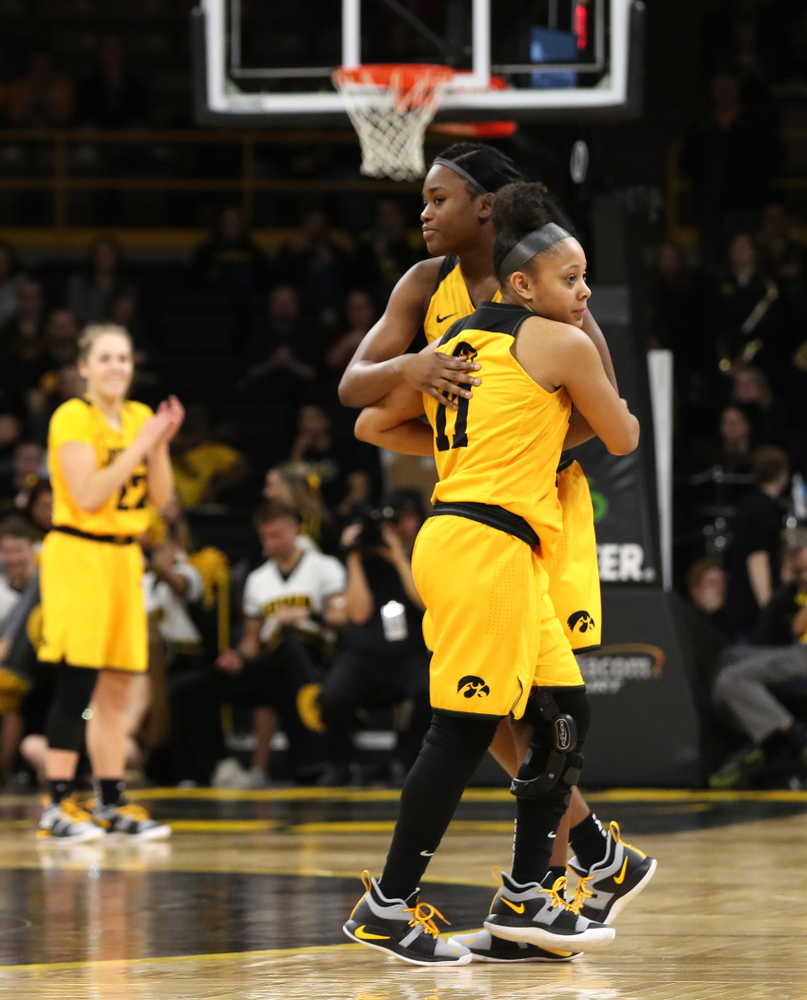 Iowa Hawkeyes guard Tania Davis (11) and guard Tomi Taiwo (1) against the Northwestern Wildcats Sunday, March 3, 2019 at Carver-Hawkeye Arena. (Brian Ray/hawkeyesports.com)