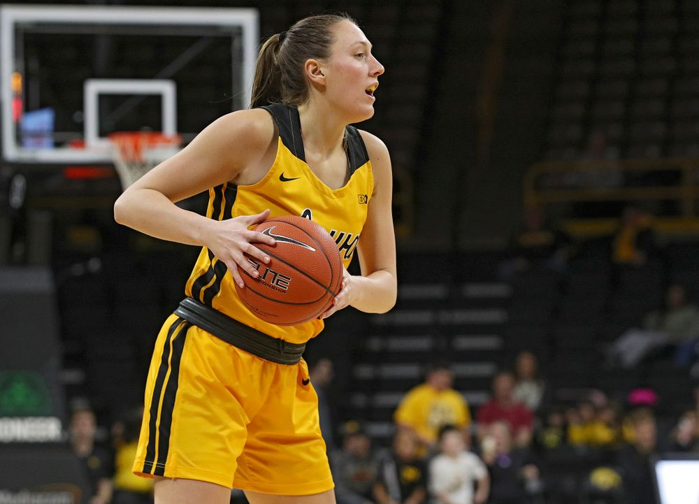 Iowa Hawkeyes forward Amanda Ollinger (43) looks to pass during the third quarter of their game at Carver-Hawkeye Arena in Iowa City on Thursday, January 23, 2020. (Stephen Mally/hawkeyesports.com)