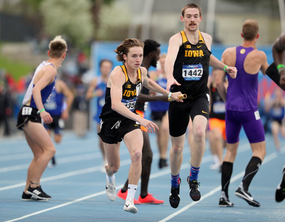 Iowa's Nathan Mylenek takes the baton from Nolan Teubel as they run the men's distance medley relay event during the third day of the Drake Relays at Drake Stadium in Des Moines on Saturday, Apr. 27, 2019. (Stephen Mally/hawkeyesports.com)