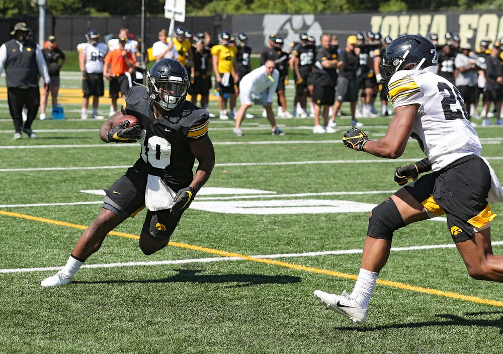 Iowa Hawkeyes running back Mekhi Sargent (10) eyes defensive back Kaevon Merriweather (26) after pulling in a pass during Fall Camp Practice No. 7 at the Hansen Football Performance Center in Iowa City on Friday, Aug 9, 2019. (Stephen Mally/hawkeyesports.com)