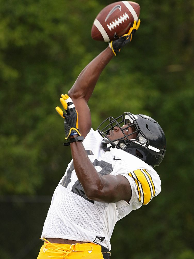 Iowa Hawkeyes defensive back D.J. Johnson (12) pulls in a ball durning Fall Camp Practice No. 17 at the Hansen Football Performance Center in Iowa City on Wednesday, Aug 21, 2019. (Stephen Mally/hawkeyesports.com)