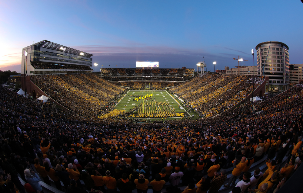 The Iowa Hawkeyes swarm the field against the Penn State Nittany Lions Saturday, October 12, 2019 at Kinnick Stadium. (Brian Ray/hawkeyesports.com)