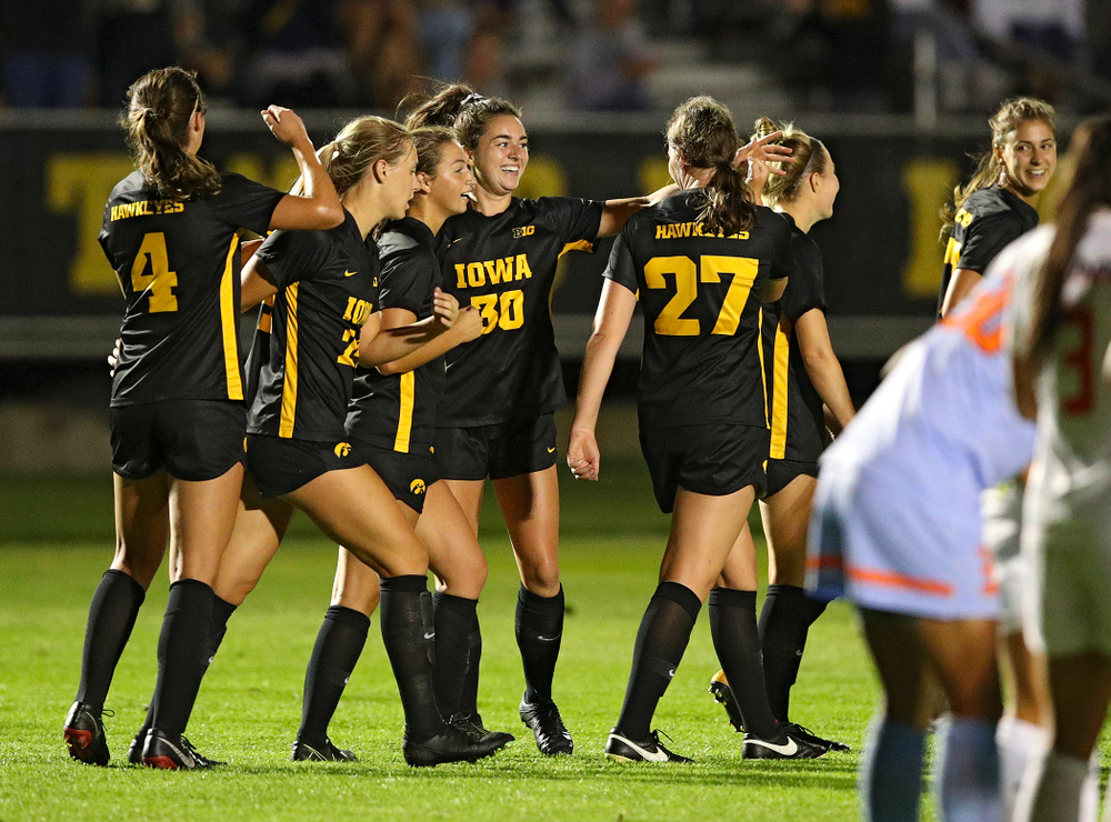 Iowa forward Devin Burns (30) celebrates her goal with teammates during the first half of their match against Illinois at the Iowa Soccer Complex in Iowa City on Thursday, Sep 26, 2019. (Stephen Mally/hawkeyesports.com)