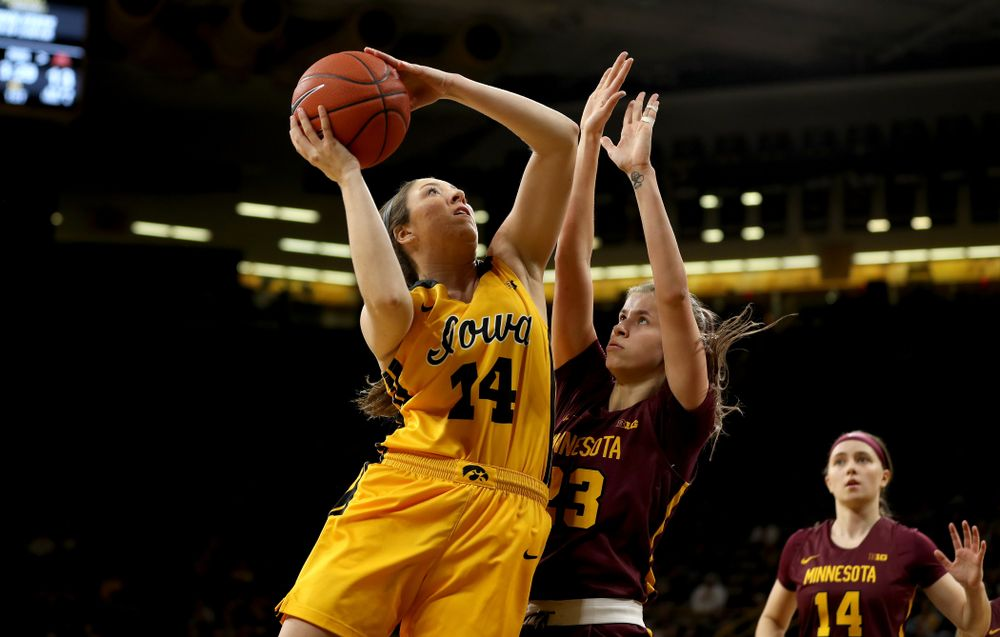 Iowa Hawkeyes forward McKenna Warnock (14) against the Minnesota Golden Gophers Thursday, February 27, 2020 at Carver-Hawkeye Arena. (Brian Ray/hawkeyesports.com)