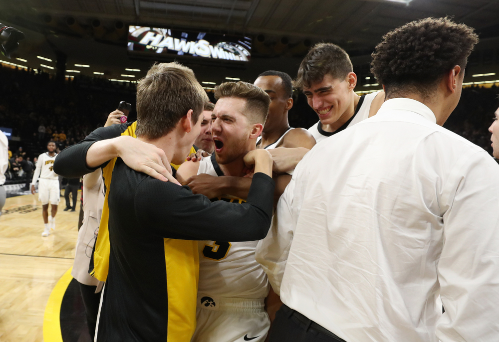 Iowa Hawkeyes guard Jordan Bohannon (3) celebrates with his teammates after making the game winning three point basket against the Northwestern Wildcats Sunday, February 10, 2019 at Carver-Hawkeye Arena. (Brian Ray/hawkeyesports.com)