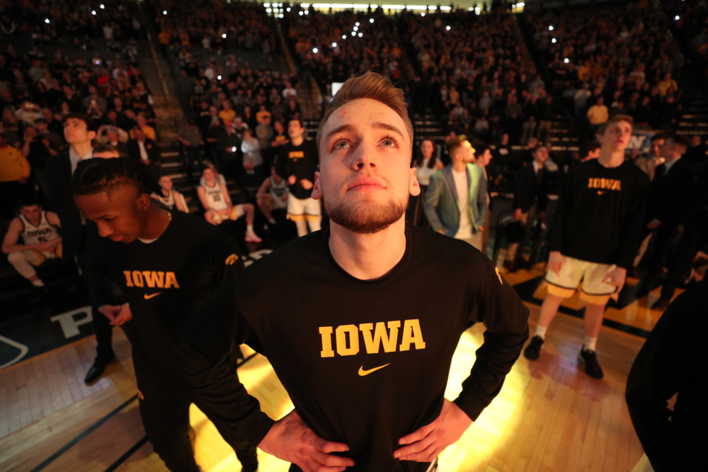 Iowa Hawkeyes forward Riley Till (20) watches the intro video before their game against the Purdue Boilermakers Tuesday, March 3, 2020 at Carver-Hawkeye Arena. (Brian Ray/hawkeyesports.com)