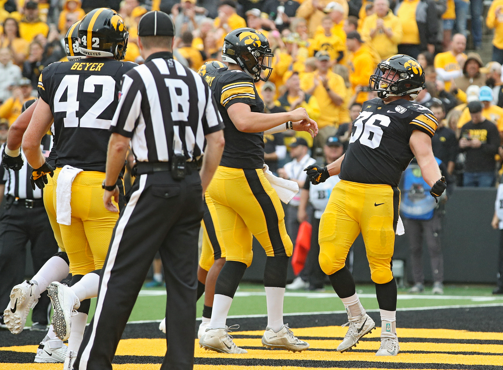Iowa Hawkeyes fullback Brady Ross (36) celebrates his 1-yard touchdown run with quarterback Nate Stanley (4) during the second quarter of their game at Kinnick Stadium in Iowa City on Saturday, Sep 28, 2019. (Stephen Mally/hawkeyesports.com)