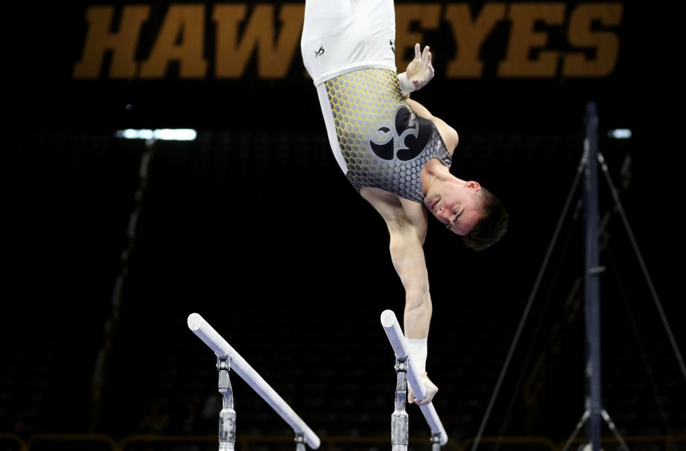 Iowa's Mitch Mandozzi competes on the parallel bars against Illinois Sunday, March 1, 2020 at Carver-Hawkeye Arena. (Brian Ray/hawkeyesports.com)