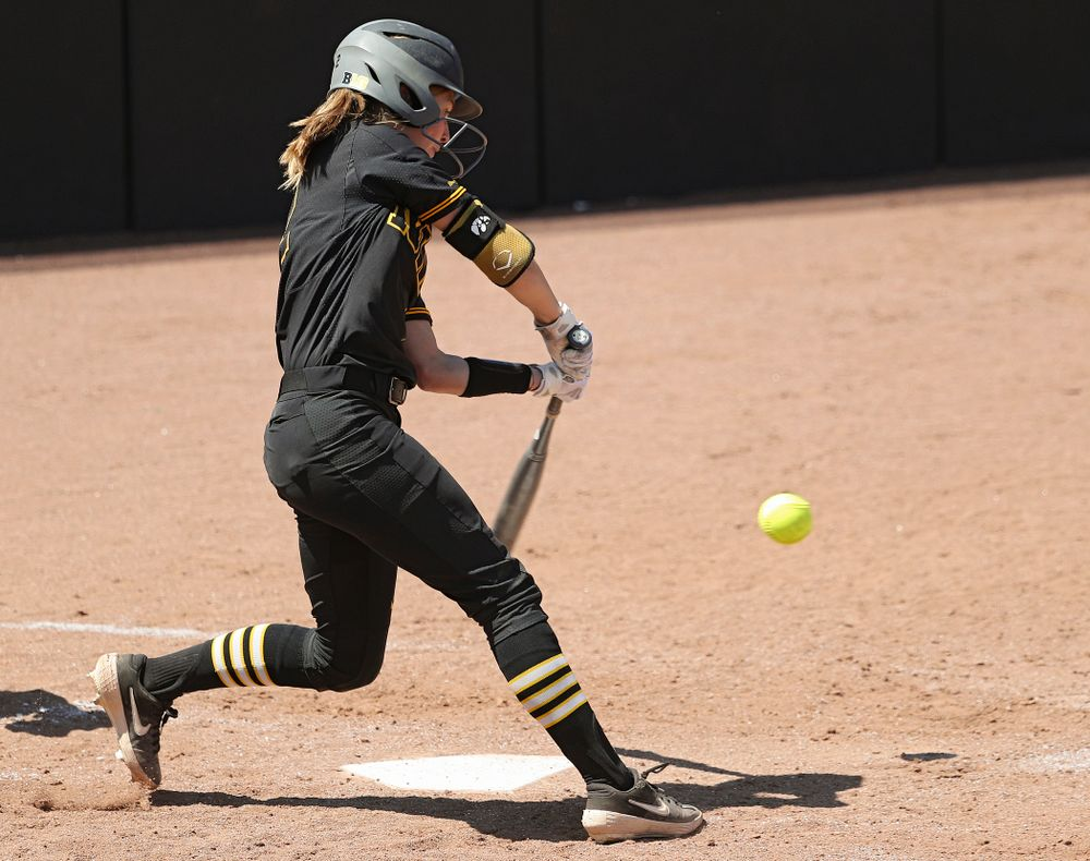Iowa second baseman Aralee Bogar (2) drives a pitch for a hit during the third inning of their game against Ohio State at Pearl Field in Iowa City on Saturday, May. 4, 2019. (Stephen Mally/hawkeyesports.com)