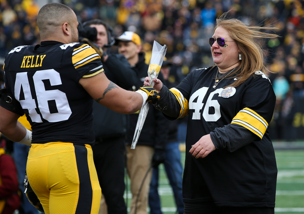 Iowa Hawkeyes fullback Austin Kelly (46) is greeted by his mother during Senior Day ceremonies before a game against Nebraska at Kinnick Stadium on November 23, 2018. (Tork Mason/hawkeyesports.com)