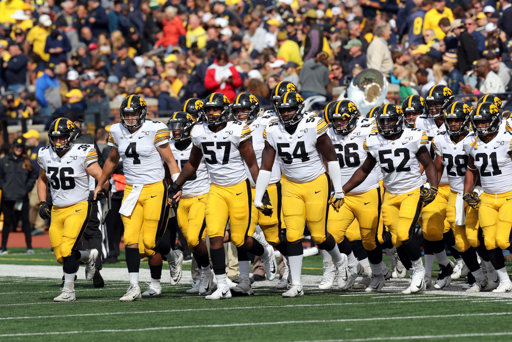 The Iowa Hawkeyes swarm out for the second half against the Michigan Wolverines Saturday, October 5, 2019 at Michigan Stadium in Ann Arbor, MI. (Brian Ray/hawkeyesports.com)