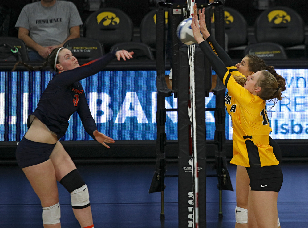 Iowa's Hannah Clayton (18) and Blythe Rients (11) block a shot during the second set of their match against Illinois at Carver-Hawkeye Arena in Iowa City on Wednesday, Nov 6, 2019. (Stephen Mally/hawkeyesports.com)